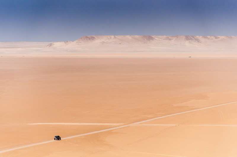 Driving through desert in Dakhla, Western Sahara