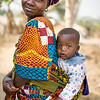 Young Liberian mother carrying her son