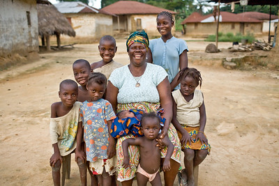 UNMIL Photo/Christophe Herwig - Ganta, Liberia, July 30, 2008 :   Tonglewin Village elder Kou Pealea has 30 grandchildren and an infection in her knee.   Before the war she was a midwife; however her clinic was burnt to the ground by soldiers. Now she delivers babies inside her home.  But every day she works in the field with the other woman in the Ganta Concerned Women's Group.