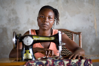 Liberian woman learning to sew