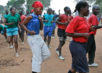 MONROVIA - LIBERIA , FEBRUARY 8 2007 :  Starting before dawn young liberian men and women attending the Polcie Academy in Monrovia go through their morning excersises before breakfeast. The UN and liberian government are driving to increase the number of women police to 20 percent (currently around 6 percent).  Special recruitment drives and extra educational incentives are part of the program.  (Photos by : Christopher Herwig )
