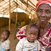 Liberian Grandmother holding a crying baby