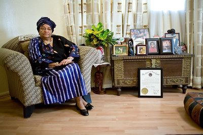 Monrovia, Liberia, on Thursday, January 18, 2007, Liberian President Ellen Johnson-Sirleaf - first elected Female head of state in Africa, at her home in Monrovia with pictures of her grandchildren and a collage of people including Oprah.