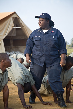 MONROVIA - LIBERIA , FEBRUARY 8 2007 : Vera Manly (077047743) Deputy Commandant fro Training. She has been in the Police force for 16 years, and sees men and her counterparts, and encourages new female recruits not to make yourself vulnerable. All recruits are treated the same in training. The president wants to encourage those women who are highschool dropouts to get an education through the new incentive program just for women run by the Ministery of Gender and UNMIL. Starting before dawn young liberian men and women attending the Polcie Academy in Monrovia go through their morning excersises before breakfeast. The UN and liberian government are driving to increase the number of women police to 20 percent (currently around 6 percent).  Special recruitment drives and extra educational incentives are part of the program.  (Photos by : Christopher Herwig )