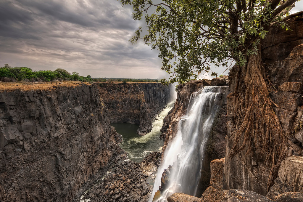 View from the edge of Victoria Falls, Zambia during low water season showing the boiling pot of churning water next to angels armchair.