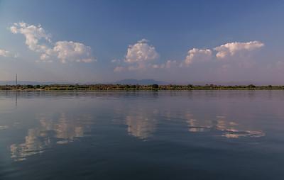 Lower Zambezi River, Zambia The calm waters of the Zambezi River reflect the clouds from above.