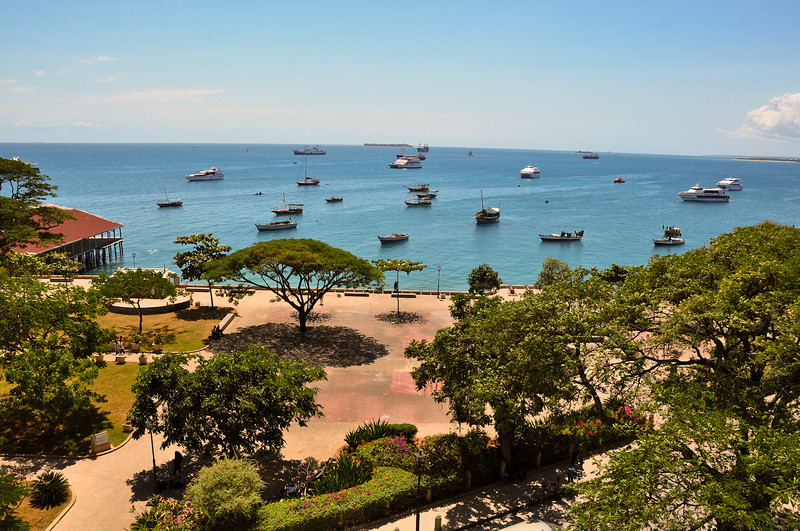 """View of the harbor from the balcony of the """"House of Wonders"""", on the seafront of Stone Town. The House of Wonders, also known as the Beit al-Ajaib, is a former Sultan's Palace, and now a museum of the island's history. Stone Town, Zanzibar"""