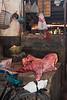 Meat vendor, Darajani Market, Stone Town,  Zanzibar, Tanzania, Africa.  March 2008