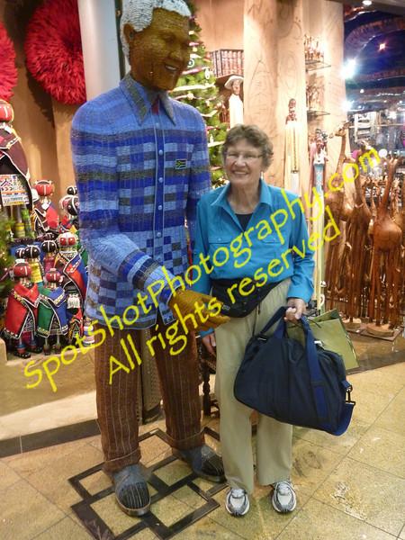 Johannesburg airport. Betty with beaded Nelson Mandela statute