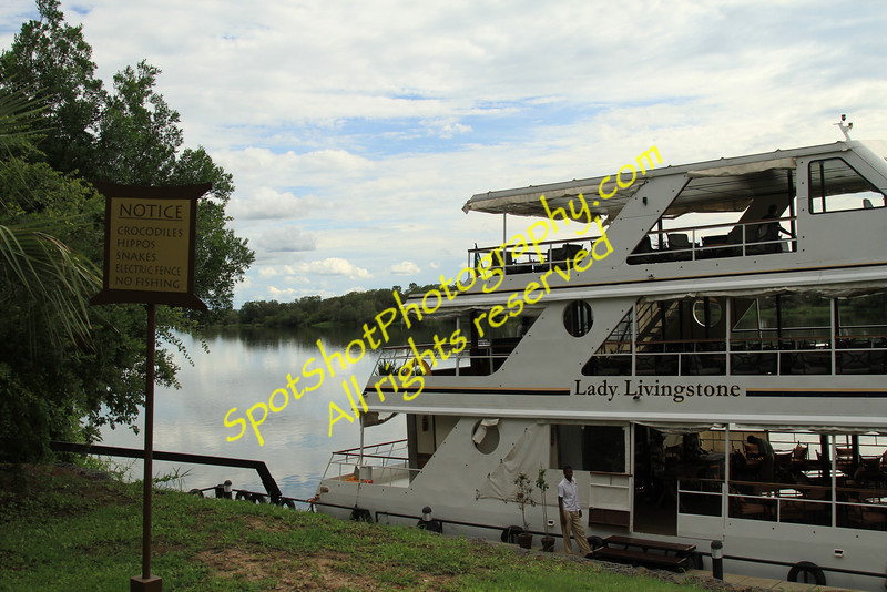 Boarding for cruise up the Zambezi River at sunset time.  No sunset due to clouds, but peaceful and beautiful nonetheless.