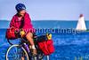 Touring cyclist on Cabot Trail, Cape Breton Island in Nova Scotia, Canada - 14 - 72 ppi