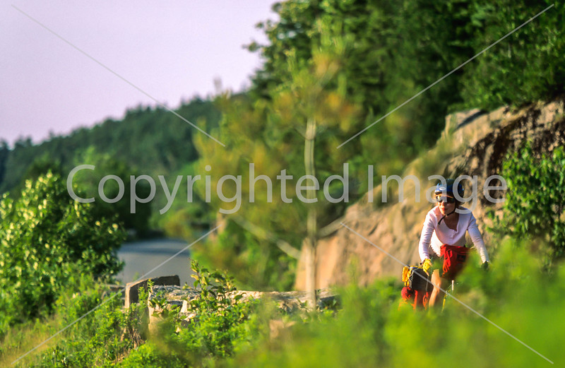 Touring cyclist on Cabot Trail, Cape Breton Island in Nova Scotia, Canada - 31 - 72 ppi