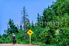 Touring cyclist on Cabot Trail, Cape Breton Island in Nova Scotia, Canada - 37 - 72 ppi