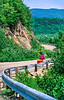 Touring cyclist on Cabot Trail, Cape Breton Island in Nova Scotia, Canada - 36 - 72 ppi