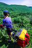 Touring cyclist on Cabot Trail, Cape Breton Island in Nova Scotia, Canada - 2 - 72 ppi