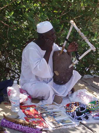 Aswan - Man playing Nubian Instrument