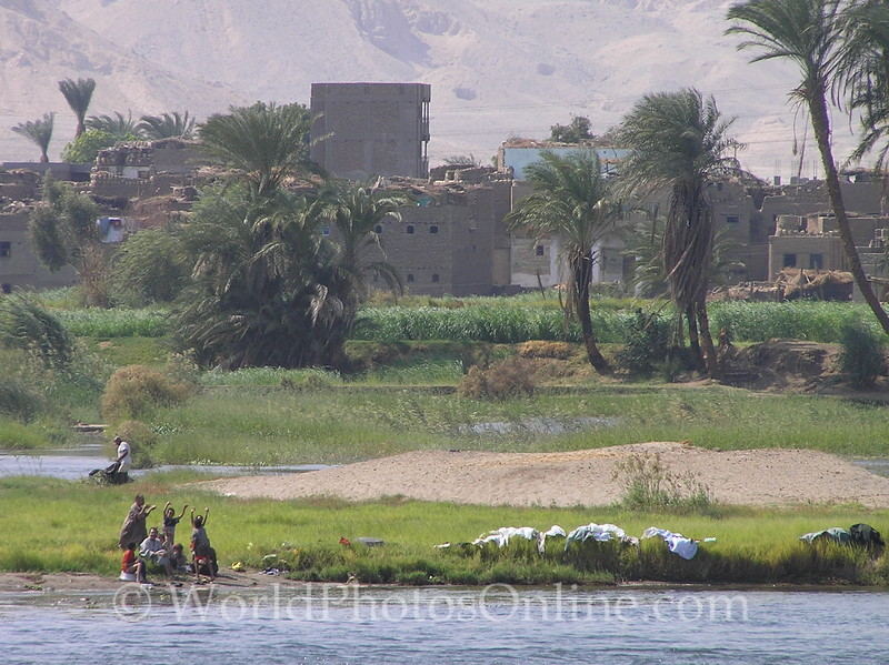 Nile River – Friendly Egyptians wave at our boat 3