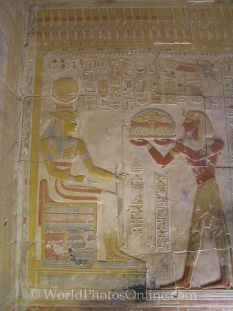 Abydos - Temple of Osiris - Wall Relief of Seti I giving offering to Hathor.  [Looks like a giant Hamburger (with everything) to me.]