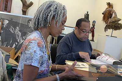 Virginia Smyly and Claude Everhardt scour through African American Historical and Cultural Society's archive. Photo by Planet Fillmore Communications.
