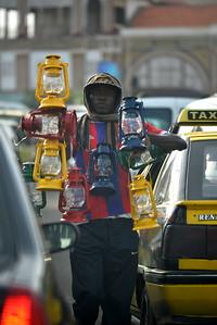 Vendeur ambulant de lampes à pétrole