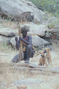 Hadzabe warrior with hunting dogs.