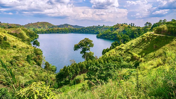 Beautiful Uganda! The lush, green, fertile landscape surrounding Lake Nyinambuga, an ancient volcanic caldera filled with water, part of the crater region in western Uganda.