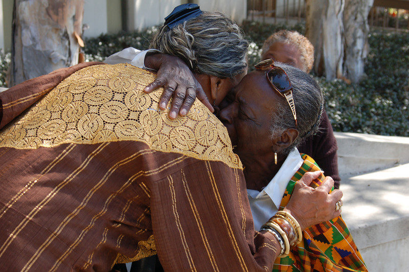 Embrace of the longing for Dr. Asa Hilliard.  Patsy Jo Hilliard embraces Lillian Mobley on their first greeting after this renowned educator and historian passed.<br /> <br /> Photo copyright Kwaku Person-Lynn, PhD