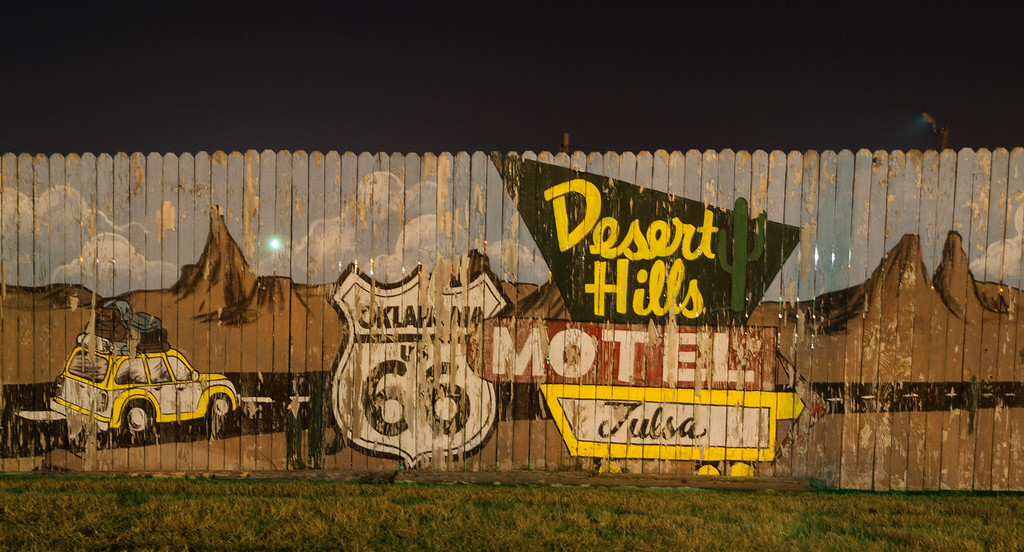 Mural painted on old wood fence at Desert Hills Motel in Tulsa, OK Nighttime shot using available light only from motel's parking area, nearby street lights, and neon signs.