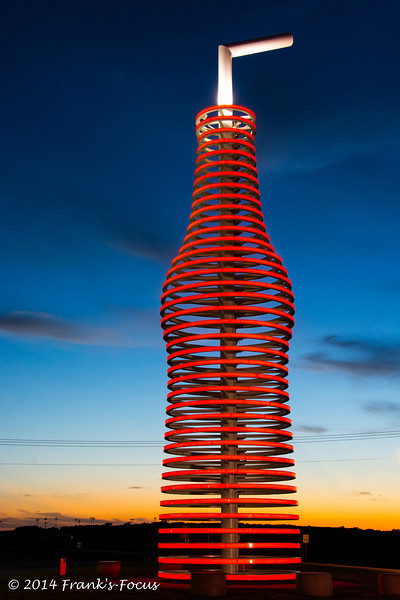"""This unique item sits along Old U.S. 66 near Arcadia, Oklahoma.  It serves as the """"sign"""" for Pops Restaurant, which opened in 2007.  This """"sign"""" appears to be constructed from spiraling neon tubes but they are actually bright LEDs which provide a spectacular light show at night.  The """"sign"""" is 66 feet tall (symbolic of the historic highway where it sits) and weighs in at 4 tons.  The establishment is owned by an Oklahoma oil & gas magnate and both this bottle and the main restaurant/store building have won several architectural awards."""
