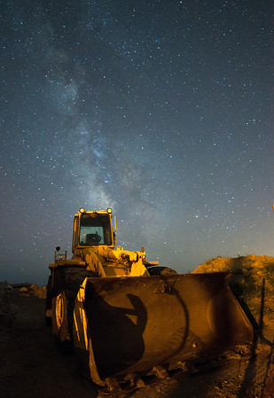 """Clear Skies, Soon"" – a heavy frontloader rests under the stars after working all day to rebuild a bulkhead at a beachfront home destroyed by Hurricane Sandy."