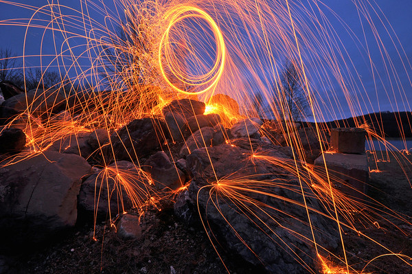 """Fire on the Rocks"" – once again, I spotted the elusive Ring of Fire—this time on a windswept, raw evening atop a pile of boulders and concrete slabs in rural Hudson Valley."