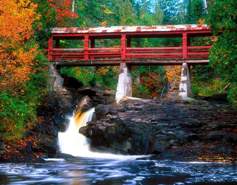 Lutsen Bridge over the Poplar River by Lutsen Resort. This image was taken during the peak of fall colors in 2007. Nikon N90s film camera, Provia film.