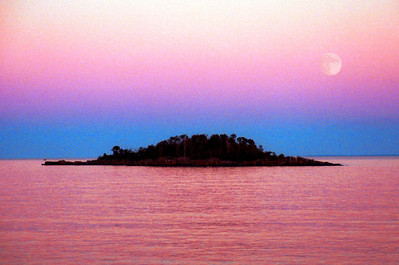 Moonrise over Lake Superior. This image was taken by Seagull Island near the town of Knife River in the early evening at dusk. I love the color of the sky. NikonN90s film camera Fuji 200 color negative film.