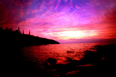 Shovelhead Sunrise. This photograph was taken back in the early 90's in Tettegouche State Park. At the time the park was mostly undeveloped, only some trails and no campground. This was my first really great sunset as I had only been shooting about 4 years at the time. I spent a week getting up at 5:30 and going to this spot. On the last day I got this shot. Prints available from this website. or form me directly. - Michael Maltese