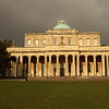 This is Pittville Pump Room, a magnificent structure built in 1825-1830, thirty years after the Arnolds' visit. The original pump and well can be seen inside. Today it serves as a premier venue for concerts, weddings, etc. The address is: East Approach Drive, Cheltenham, Gloucester, UK