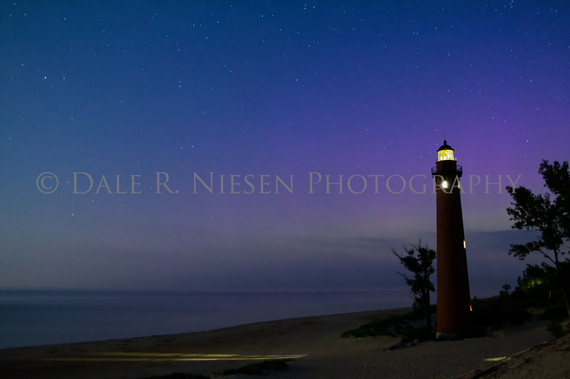 The northern lights and Little Sable Lighthouse at Silver Lake State Park and sand dunes near the town of Silver Lake, Michigan taken Sunday July 14, 2013.