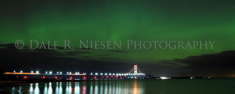 The aurora over the Big Mac Bridge sadly for me the north half of the bridge and tower had a power outage November 13, 2012.  This image was taken in the early hours of November 14, 2012 from Mackinaw City, Michigan.