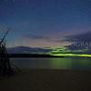 The aurora borealis over Sand Point Beach  and Grand Island, Pictured Rocks National Lakeshore, Munising, Michigan.