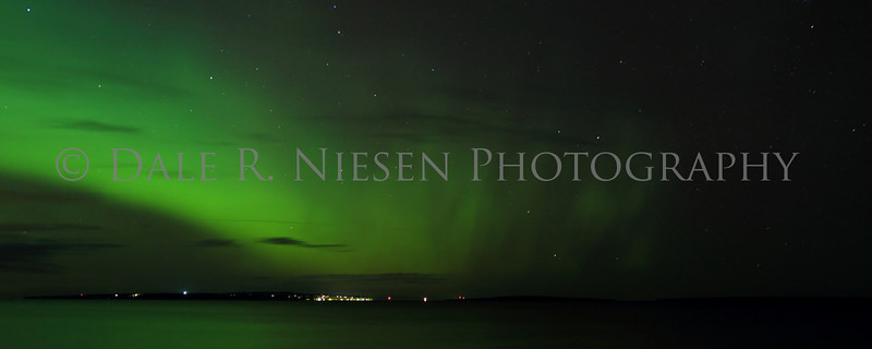 The Aurora Borealis over the Straits of Mackinac with Mackinac and Round Island at the horizon.  Taken from Mackinaw City, Michigan on November 14, 2012.