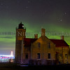 Old Mackinac Point Lighthouse and the Mackinac Bridge with northern lights dancing in the sky above taken November 14, 2012, Mackinaw City, Michigan.