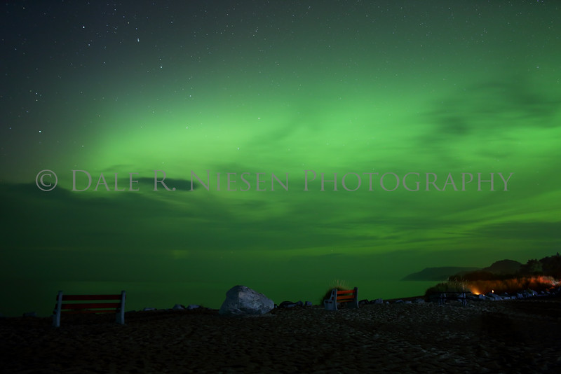 The aurora fills the sky above Lake Michigan and the Sleeping Bear Dunes taken from the public park at Empire, Michigan on 9/7/2015.