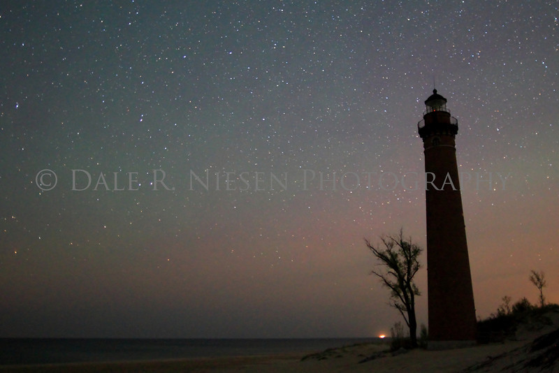 A light green and red airglow surrounds the Little Sable Lighthouse on the morning of May 19, 2013.   Little Sable is located on Lake Michigan near Silver Lake, Michigan south of the sand dunes the lighthouse is a part of the Silver Lake State Park.