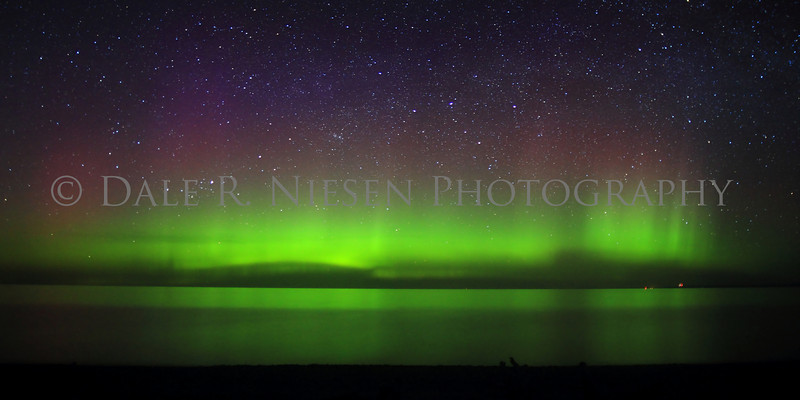The Aurora Borealis/Northern Lights over Lake Superior at Whitefish Point taken 5/7/2013 near Paradise, Michigan.  It was a calm night on the lake allowing for a wonderful reflection of the lights.  Note: Special steps may need to be taken when ordering a panoramic image please review the panoramic print sizes for cropping. However the 15 x 30 size print appears to be a perfect fit for the above image without cropping.