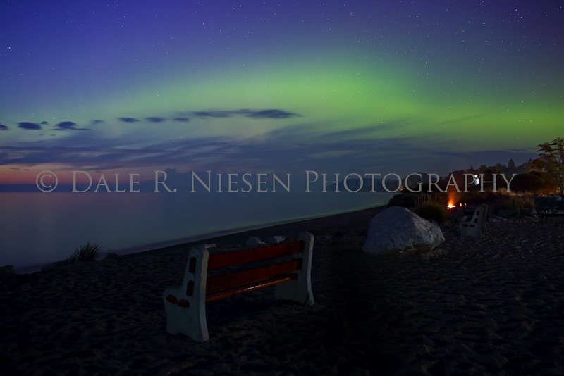 Twilight on the beach at Empire, Michigan as the sun slowly sets the Aurora Borealis competes for its place in the evening sky over the Sleepy Bear Dunes.