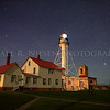 The night sky above the historic Whitefish Point Lighthouse on Whitefish Bay, Lake Superior near Paradise, Michigan.
