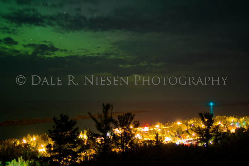 Copper Harbor, Michigan with the Northern Lights and clouds above taken July 7, 2013.