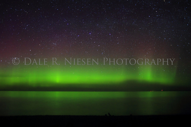 The Aurora Borealis/Northern Lights over Lake Superior at Whitefish Point taken in the early hours of 5/7/2013 near Paradise, Michigan.  It was a calm night on the lake allowing for a wonderful reflection of the lights.