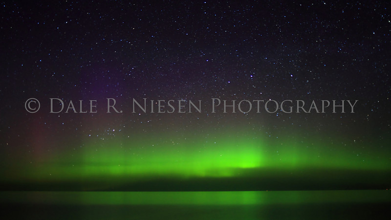 The Aurora Borealis/Northern Lights over Lake Superior at Whitefish Point taken 5/7/2013 near Paradise, Michigan.  It was a calm night on the lake allowing for wonderful reflections of the lights.
