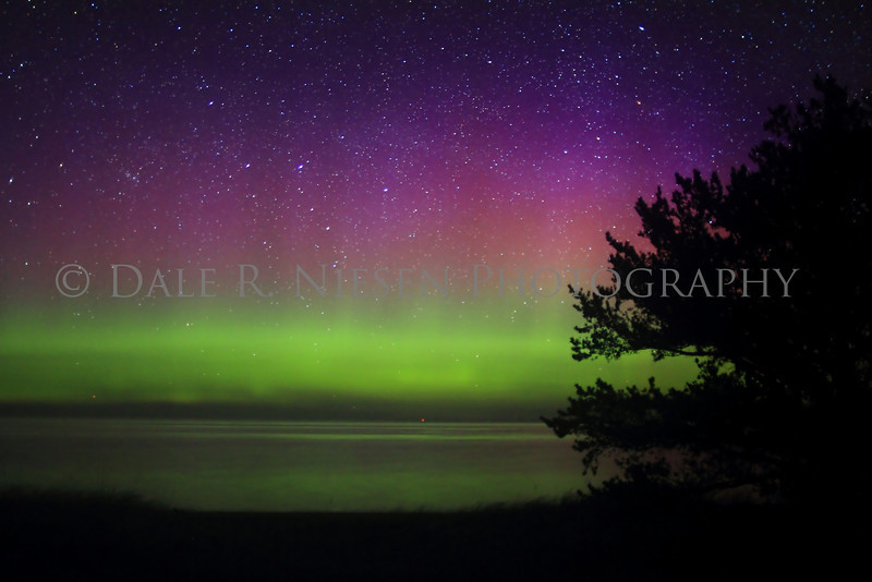 The Aurora Borealis/Northern Lights over Lake Superior at Whitefish Point taken 5/6/2013 near Paradise, Michigan.  It was a calm night on the lake allowing for a wonderful reflection of the lights.