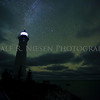 Crisp Point Light on a mostly cloudy night showing the Milky Way and  faint greenish aurora or airglow.  Crisp Point Lighthouse is located near Newberry, Michigan on the shore of Lake Superior.